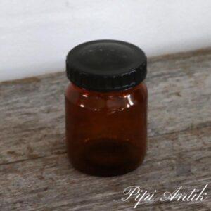 Brun krukke med sort plastlåg Ø7,5xH11 cm