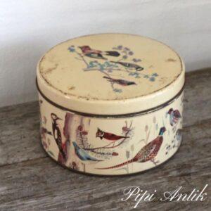 Kagedåse i creme med fuglemotiver Ø22x12 cm