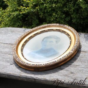 Ovalt foto guldramme med billede L38xB30xD2,5cm